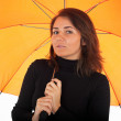 Young woman with orange umbrella — Stock Photo #3175111