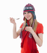 Young woman with spoon of syrup — Stock Photo