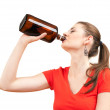 Alcoholic woman drinking with bottle - Stok fotoraf