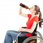 Alcoholic woman on wheelchair — Stock Photo