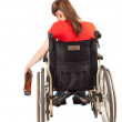 Alcoholic woman on the wheelchair — Stock Photo