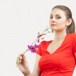 Young woman with orchid — Stock Photo #3352356