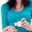 Young woman pouring out drugs on palm — Stock Photo #3405823