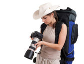 Female tourist with backpack and camera — Stock Photo