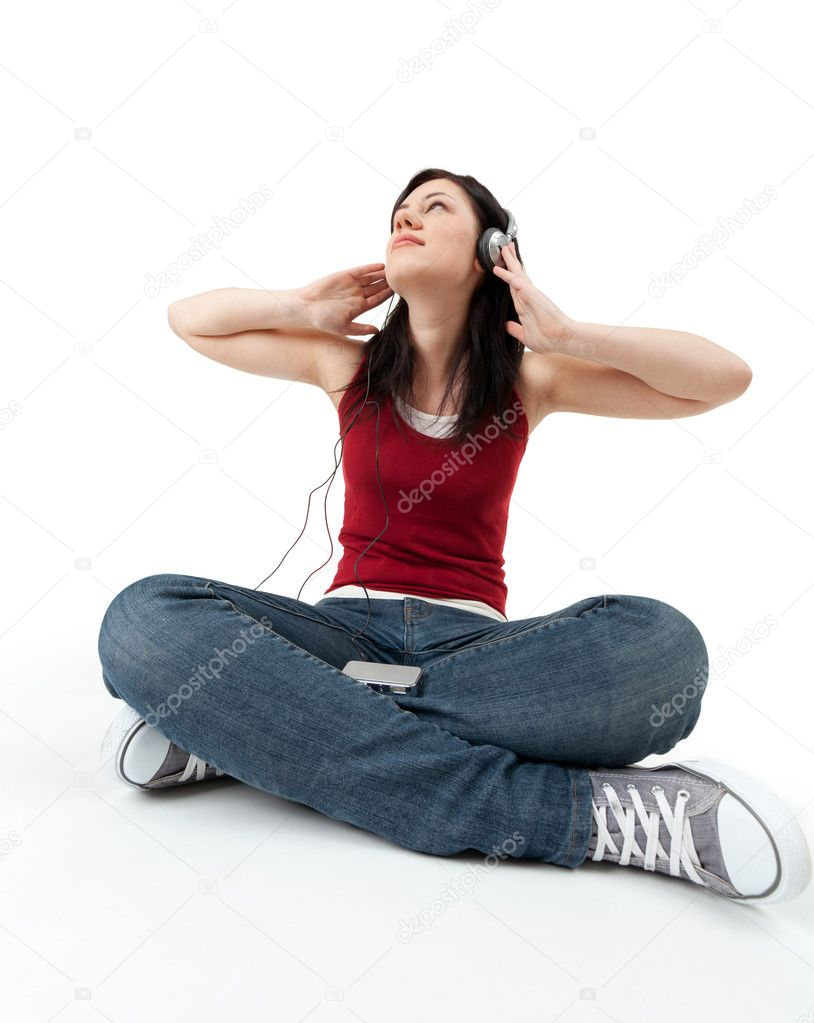 Sitting on the floor young woman listening music from mp3 player — Stock Photo #3405765