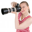 Stock Photo: Female Photographer Shooting