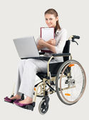 Smiling businesswoman on wheelchair — Stock Photo