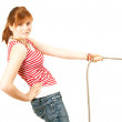 Young girl pulling rope — Stock Photo
