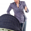 Angry shouting mother and baby buggy — Stock Photo