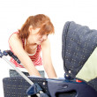 Mother and baby  carriage — Stock Photo