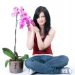 Beautiful young woman with orchid — Stock Photo