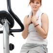 Woman on stationary training bicycle - Stock Photo