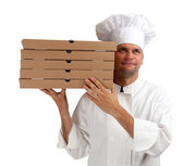 Cook with boxes of pizza — Stock Photo