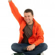 Young man in orange sweatshirt - Stock Photo