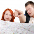 Tourist couple with map — Stock Photo #3676866