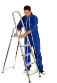 Man with metal ladder — Stock Photo
