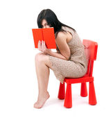 Woman covering face book — Stockfoto