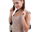 Woman speaks by a mobile phone — Stock Photo