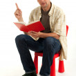 Sitting young man reading book — Stock Photo