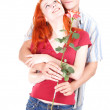 Romantic lovers with rose — Stock Photo