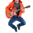 Jumping joyful guitarist — Stock Photo