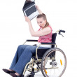 Angry womwith laptop on wheelchair — Stock Photo #3906330