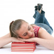 Girl sleeping on the stack of books - Stock Photo