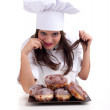 Female chef and doughnuts — Stockfoto