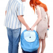 Couple with part of baby stroller — Stock Photo