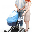 Stock Photo: Parents with baby stroller