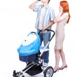 Parents with baby stroller and alcohol — Stock Photo