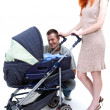 Parentswith baby stroller — Stock Photo #3906864