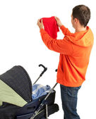 Young father with baby stroller — Stockfoto