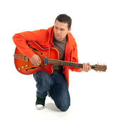 Young man with electric guitar — Stock Photo