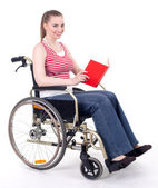 Woman with book on the wheelchair — Stock Photo