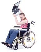 Angry woman with laptop on wheelchair — Stock Photo