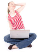 Stretching woman working on laptop — Stock Photo