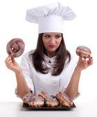 Szacowanie ciasto pani gotować i pączki — Zdjęcie stockowe
