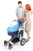 Parents with baby stroller — Stock Photo