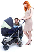 Parentswith baby stroller — Stock Photo