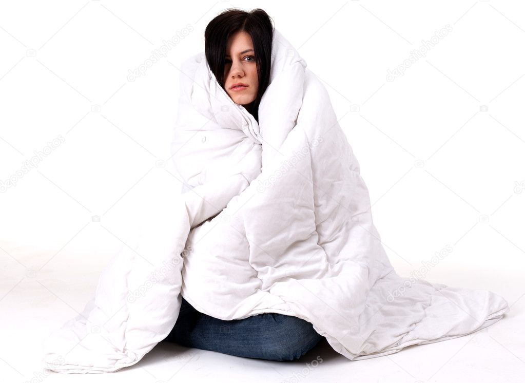 Young woman covering her head and body by the duvet   Stock Photo #3904601