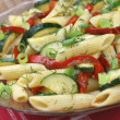 Pasta with paprika and zucchini — Stock Photo