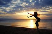Dancing in sunset sea — Stock Photo