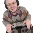 Silly nerd as a dj over white background — Stock Photo