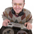 Silly nerd as a dj over white background - Stock fotografie