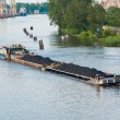 Coal barge sailing on the river — Stock Photo #3670488