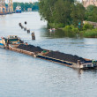 Coal barge sailing on the river — Stock Photo