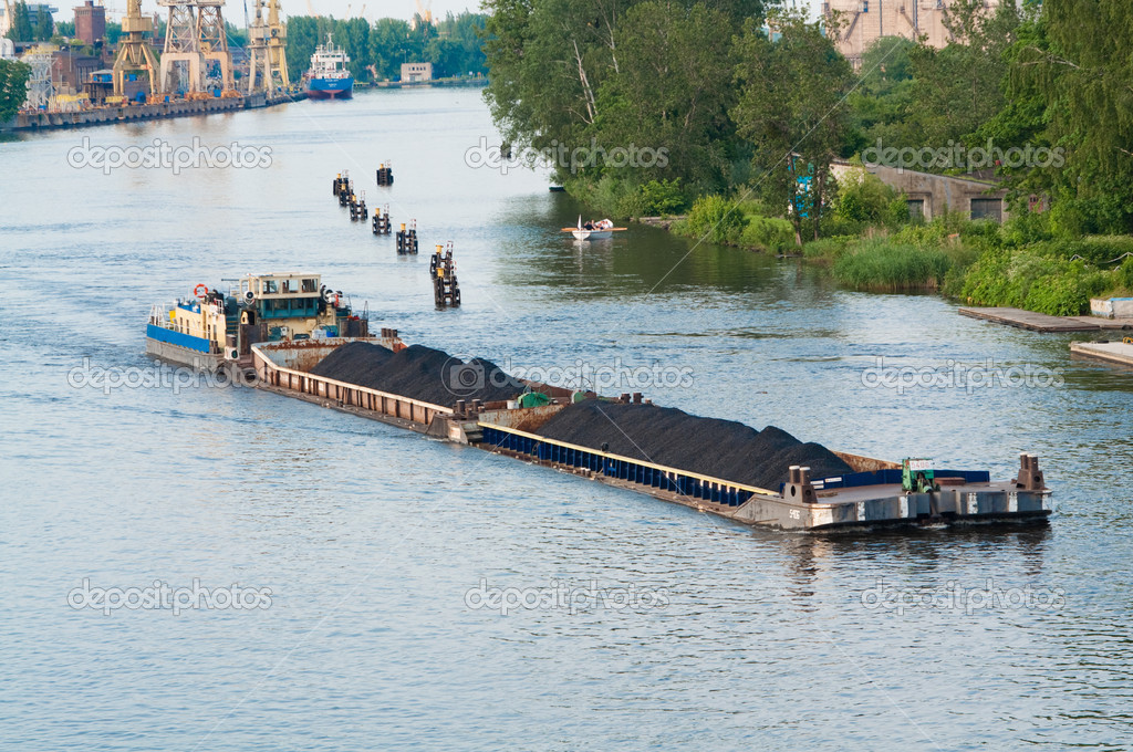 Coal barge sailing on the river with cargo  Stock Photo #3670488