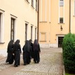 Nuns walking on the square — Stock fotografie