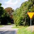 Stock Photo: Yield sign near crossroad